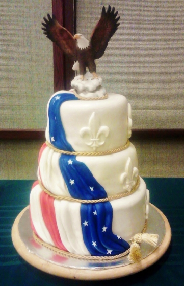 Vanilla, red velvet, and chocolate tiers covered in mm fondant with white chocolate fleur di lis.